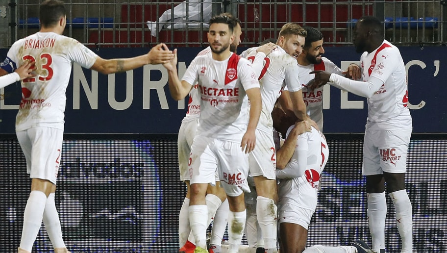 Nîmes' French defender Loick Landre (2ndR) celebrates with teammates after scoring during the French L1 football match between Stade Malherbe Caen and Nimes Olympique at the Michel d'Ornano stadium, in Caen, northwestern France on December 5, 2018. (Photo by CHARLY TRIBALLEAU / AFP)        (Photo credit should read CHARLY TRIBALLEAU/AFP/Getty Images)