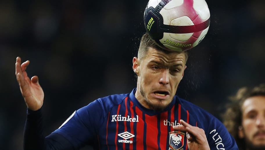 Caen's French defender Frederic Guilbert heads the ball during the French L1 football match between Caen (SMC) and Rennes (SRFC) on November 3, 2018 at the Michel d'Ornano stadium in Caen, Normandy. (Photo by CHARLY TRIBALLEAU / AFP)        (Photo credit should read CHARLY TRIBALLEAU/AFP/Getty Images)