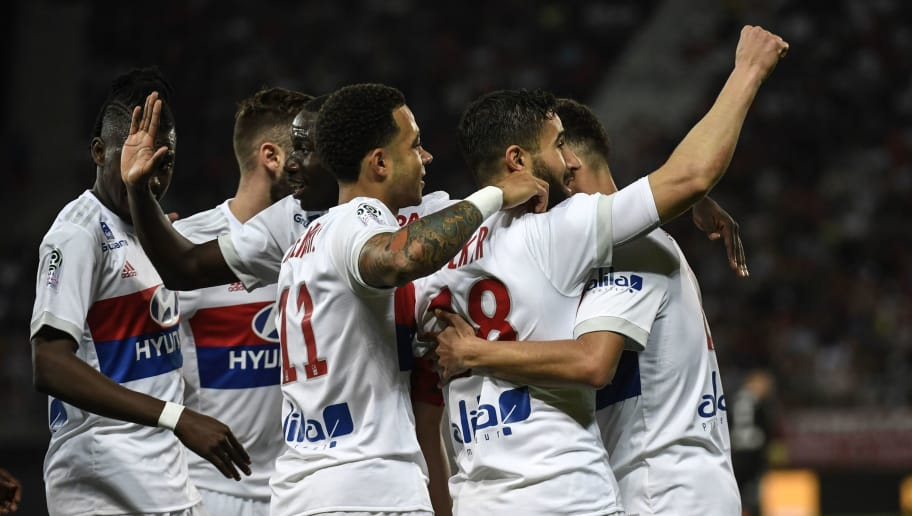 Lyon's French midfielder Nabil Fekir (R) is congratuled by teamates after scoring during the French L1 football match between Dijon FCO and Olympique Lyonnais, on April 20, 2018, at the Gaston Gérard Stadium in Dijon, central France. (Photo by PHILIPPE DESMAZES / AFP)        (Photo credit should read PHILIPPE DESMAZES/AFP/Getty Images)