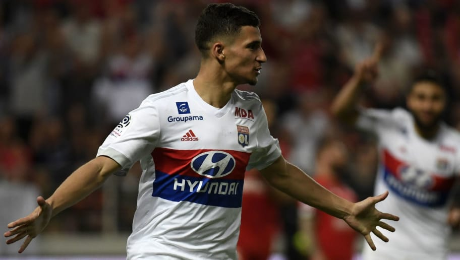 Lyon's forward Houssem Aouar reacts after scoring during the French L1 football match between Dijon FCO and Olympique Lyonnais, on April 20, 2018, at the Gaston Gérard Stadium in Dijon, central France. (Photo by PHILIPPE DESMAZES / AFP)        (Photo credit should read PHILIPPE DESMAZES/AFP/Getty Images)