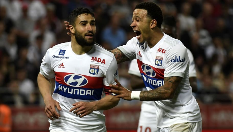 Lyon's French midfielder Nabil Fekir (L) is congratuled by teamate Lyon's Dutch forward Memphis Depay (R) after scoring during the French L1 football match between Dijon FCO and Olympique Lyonnais, on April 20, 2018, at the Gaston Gérard Stadium in Dijon, central France. (Photo by PHILIPPE DESMAZES / AFP)        (Photo credit should read PHILIPPE DESMAZES/AFP/Getty Images)