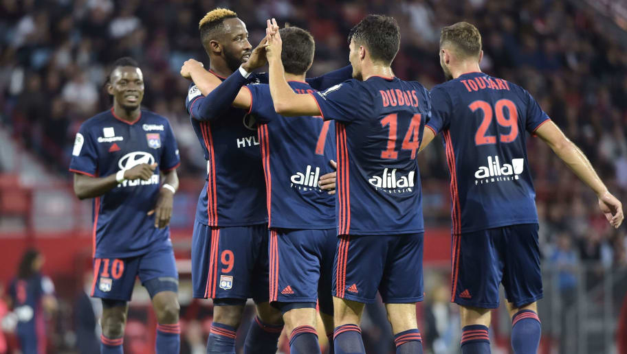 Lyon's Spanish forward Moussa Dembele (2ndL) celebrates with teammates after scoring a goal during the French L1 football match between Dijon (DFCO) and Lyon (OL) on September 26, 2018, at the Gaston Gerard Stadium in Dijon, central-eastern France. (Photo by ROMAIN LAFABREGUE / AFP)        (Photo credit should read ROMAIN LAFABREGUE/AFP/Getty Images)