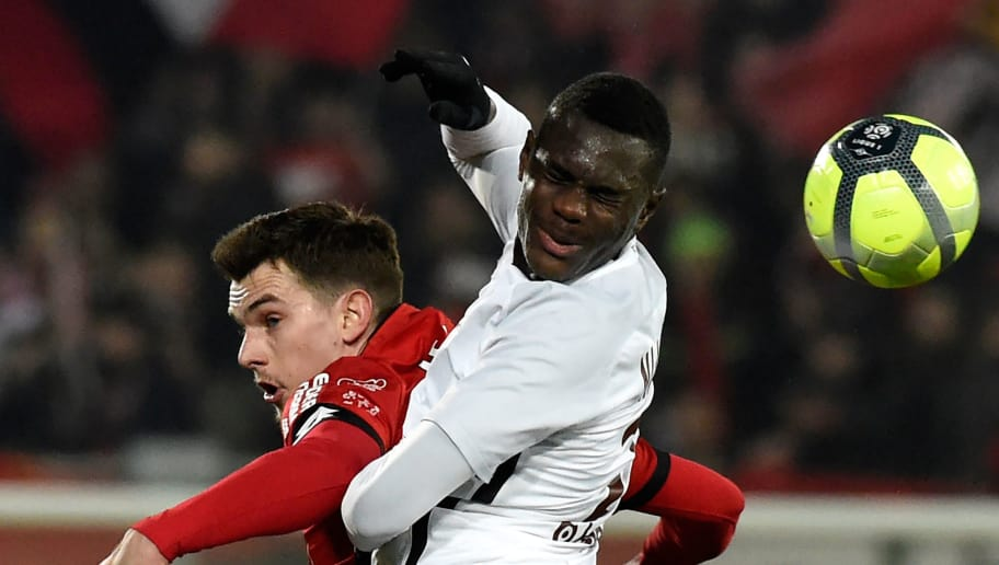 Dijon's French forward Benjamin Jeannot (L) vies with Metz' French defender Moussa Niakhate (R) during the French L1 football match Dijon (DFCO) vs Metz (FCM) on January 13, 2018 in Gaston Gerard stadium in Dijon. / AFP PHOTO / JEAN-PHILIPPE KSIAZEK        (Photo credit should read JEAN-PHILIPPE KSIAZEK/AFP/Getty Images)
