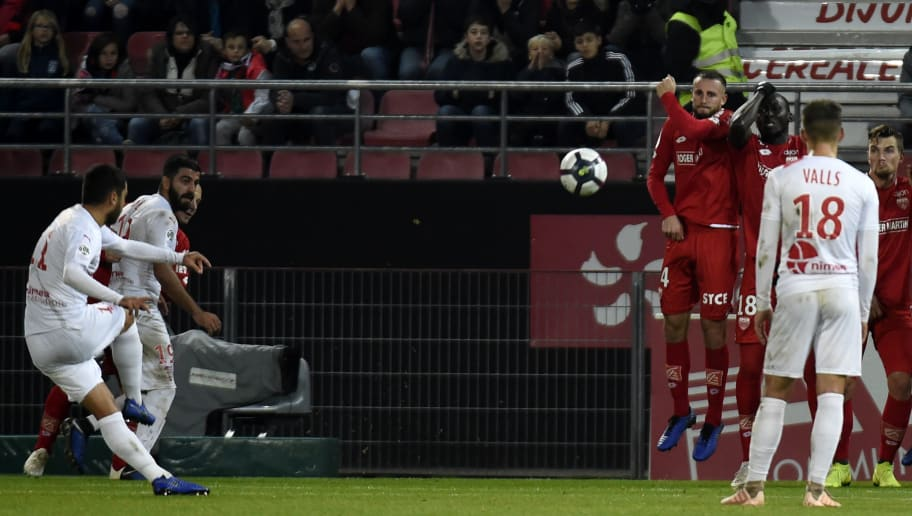 Nimes' French midfielder Teji Savanier (L) kicks the ball and scores a goal during  the French L1 football match between Dijon and Nîmes at the Gaston Gerard stadium in Dijon on November 3, 2018. (Photo by JEAN-PHILIPPE KSIAZEK / AFP)        (Photo credit should read JEAN-PHILIPPE KSIAZEK/AFP/Getty Images)