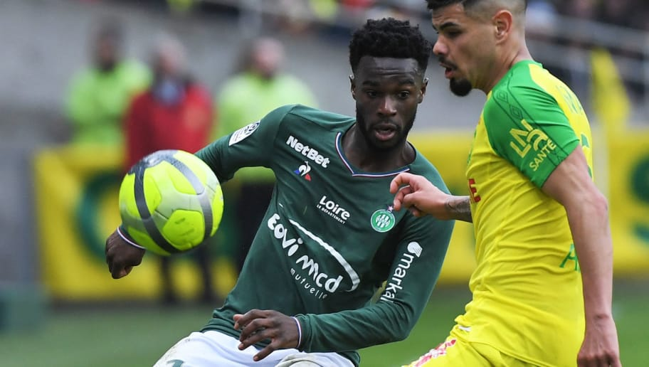 Saint-Etienne's French forward Jonathan Bamba (L) fights for the ball with Nantes' Brazilian defender Lima during the French L1 football match between Nantes and Saint-Etienne at The La Beaujoire Stadium in Nantes, western France, on April 1, 2018.  / AFP PHOTO / LOIC VENANCE        (Photo credit should read LOIC VENANCE/AFP/Getty Images)