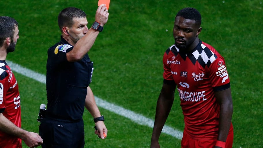 Guingamp's French forward Marcus Thuram (R) is shown a red card by referee during the French L1 football match between Guingamp (EAG) and Montpellier (MHSC)at the Roudourou stadium, in Guingamp, northwestern France on October 6, 2018. (Photo by CHARLY TRIBALLEAU / AFP)        (Photo credit should read CHARLY TRIBALLEAU/AFP/Getty Images)