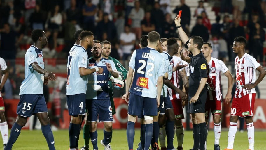 The referee gives a red card to Le Havre's French midfielder Jean-Philippe Mateta during the French second-division playoff between AC Ajaccio and Le Havre at the Francois Coty stadium in Ajaccio, on the French Mediterranean island of Corsica, on May 20, 2018. (Photo by PASCAL POCHARD-CASABIANCA / AFP)        (Photo credit should read PASCAL POCHARD-CASABIANCA/AFP/Getty Images)