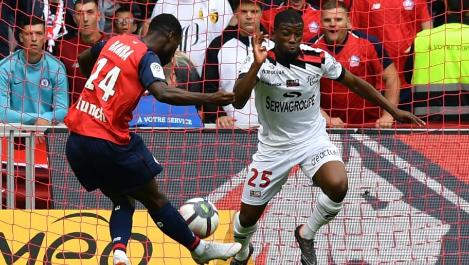 Lille's French midfielder Jonathan Bamba (L) shoots to score past Guingamp's French defender Cheikh Traoré during the French L1 football match between Lille OSC (LOSC) and Guingamp at The Pierre-Mauroy Stadium in Villeneuve d'Ascq, near Lille, northern France, on August 26 , 2018. (Photo by DENIS CHARLET / AFP)        (Photo credit should read DENIS CHARLET/AFP/Getty Images)
