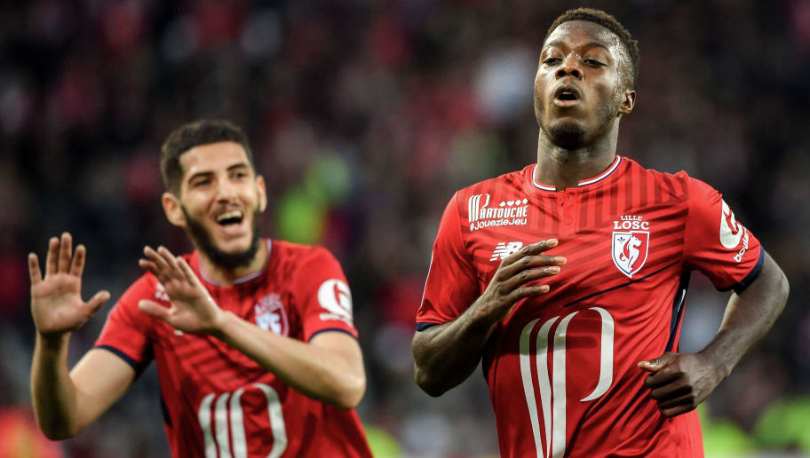 Lille's Ivorian forward Nicolas Pepe (L) celebrates after scoring a goal  during the French L1 football match between Lille and Metz on April 28 2018 at the Pierre Mauroy Stadium in Villeneuve-d'Ascq, northern France. (Photo by PHILIPPE HUGUEN / AFP)        (Photo credit should read PHILIPPE HUGUEN/AFP/Getty Images)