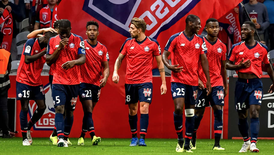 Lille's Ivorian forward Nicolas Pepe (L) celebrates with teammates after scoring a goal during the French L1 football match between Lille and Rennes on August 11, 2018 at the 'Pierre Mauroy' Stadium, in Villeneuve-d'Ascq, northern France. (Photo by PHILIPPE HUGUEN / AFP)        (Photo credit should read PHILIPPE HUGUEN/AFP/Getty Images)