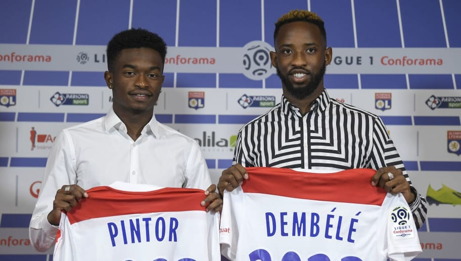 French forward Moussa Dembele (R) and Lenny Pintor (L) pose with thier new jersies of L'Olympique Lyonnais during an official presentation on September 1, 2018, at the Groupama Stadium in Decines-Charpieu near Lyon, central-eastern France. (Photo by PHILIPPE DESMAZES / AFP)        (Photo credit should read PHILIPPE DESMAZES/AFP/Getty Images)
