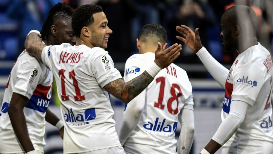 Lyon's Dutch forward Memphis Depay (L) is congratuled by teammates after scoring a goal during the French L1 football match between Olympique Lyonnais (OL) and Amiens Sporting Club, on April 14, 2018, at the Groupama Stadium in Decines-Charpieu near Lyon, central-eastern France.  / AFP PHOTO / PHILIPPE DESMAZES        (Photo credit should read PHILIPPE DESMAZES/AFP/Getty Images)