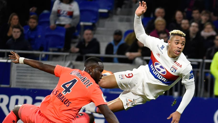 Caen's Ivorian midfielder Ismael Diomande (L) vies with Lyon's Spanish forward Mariano Diaz (R) during the French L1 football match Lyon (OL) vs Caen (SMC), on March 11, 2018 at the Groupama stadium in Décines-Charpieu near Lyon, southeastern France.  / AFP PHOTO / JEAN-PHILIPPE KSIAZEK        (Photo credit should read JEAN-PHILIPPE KSIAZEK/AFP/Getty Images)