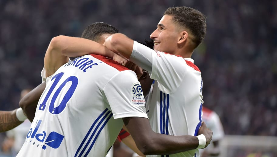 Lyon's Burkinabe forward Bertrand Traore (L) celebrates with Lyon's French midfielder Houssem Aouar (R) and team mates after scoring a goal during the French L1 football match between Lyon (OL) and Marseille (OM) on September 23, 2018 at the Groupama stadium in Décines-Charpieu near Lyon. (Photo by ROMAIN LAFABREGUE / AFP)        (Photo credit should read ROMAIN LAFABREGUE/AFP/Getty Images)