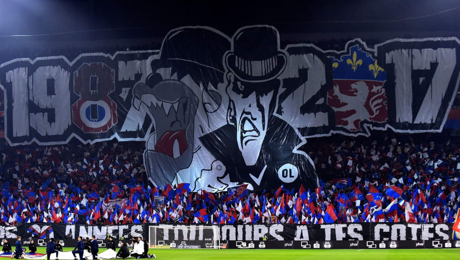 Lyon's fans hold a banner reading 1987-2017 as they celebrate the 30 years anniversary of the supporters club 'Bad Gones' during the French L1 football match between Lyon (OL) and Marseille (OM) on December 17, 2017, at the Groupama stadium in Decines-Charpieu near Lyon, central-eastern France. / AFP PHOTO / ROMAIN LAFABREGUE        (Photo credit should read ROMAIN LAFABREGUE/AFP/Getty Images)