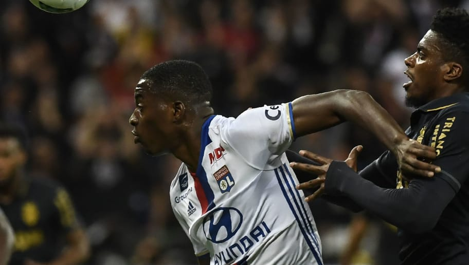 Lyon's French forward Jean-philippe Mateta (L) vies with Monaco's Brazilian defender Jemerson (R) during the French L1 football match Olympique Lyonnais against AS Monaco, on April 23, 2017 at Parc Olympique Lyonnais stadium in Décines-Charpieu near Lyon, southeastern France.      / AFP PHOTO / PHILIPPE DESMAZES        (Photo credit should read PHILIPPE DESMAZES/AFP/Getty Images)