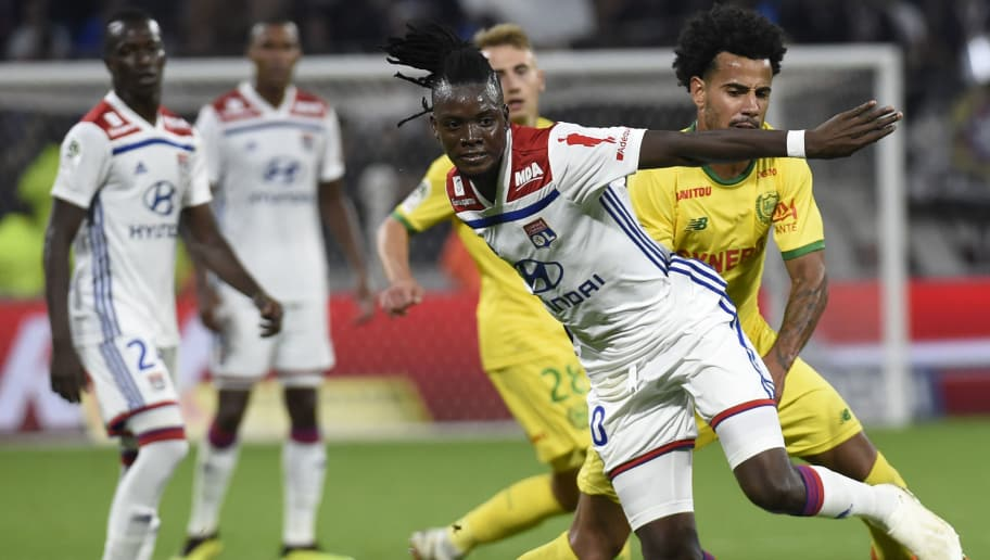 Lyon's Burkinabe forward Bertrand Traore (L) vies with Nantes' Brazilian  midfielder Lucas Evangelista (R) during the French L1 football match Lyon (OL) vs Nantes (FCN), on September 29, 2018  in Décines-Charpieu near Lyon. (Photo by JEAN-PHILIPPE KSIAZEK / AFP)        (Photo credit should read JEAN-PHILIPPE KSIAZEK/AFP/Getty Images)