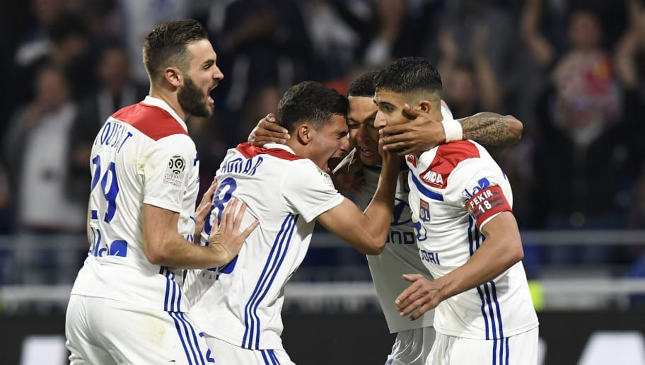 Lyon's Dutch forward Memphis Depay (2ndR) is congratuled by teammates Lyon's French midfielder Lucas Tousart (L), Lyon's forward Houssem Aouar (2ndL) and Lyon's French midfielder Nabil Fekir (R) after scoring during the French L1 football match between Olympique Lyonnais and OGC Nice, on May 19, 2018, at the Groupama Stadium in Decines-Charpieu near Lyon, central-eastern France. (Photo by PHILIPPE DESMAZES / AFP)        (Photo credit should read PHILIPPE DESMAZES/AFP/Getty Images)