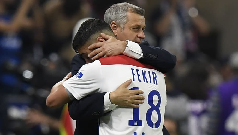 Lyon's French midfielder Nabil Fekir is congratuled by Lyon's French head coach Bruno Genesio while he leaves the field during the French L1 football match between Olympique Lyonnais and OGC Nice, on May 19, 2018, at the Groupama Stadium in Decines-Charpieu near Lyon, central-eastern France. (Photo by PHILIPPE DESMAZES / AFP)        (Photo credit should read PHILIPPE DESMAZES/AFP/Getty Images)