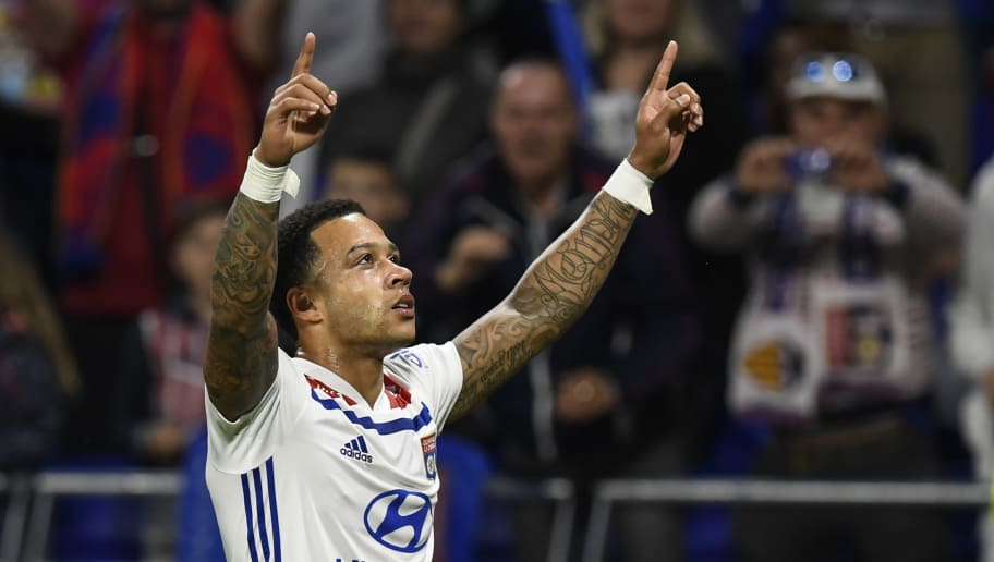 Lyon's Dutch forward Memphis Depay reacts after scoring during the French L1 football match between Olympique Lyonnais and OGC Nice, on May 19, 2018, at the Groupama Stadium in Decines-Charpieu near Lyon, central-eastern France. (Photo by PHILIPPE DESMAZES / AFP)        (Photo credit should read PHILIPPE DESMAZES/AFP/Getty Images)