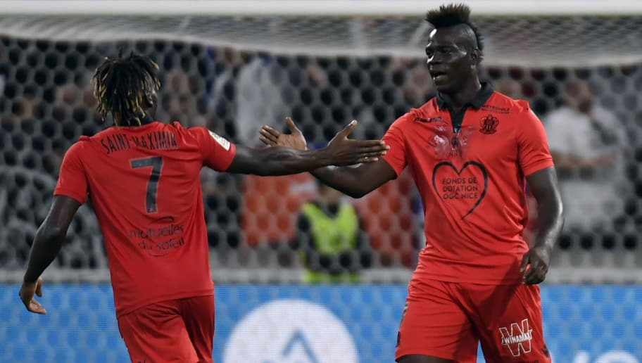 Nice's French midfielder Allan Saint-Maximin (L) is congratulated by Nice's Italian forward Mario Balotelli (R) during the French L1 football match between Olympique Lyonnais and OGC Nice on August 31, 2018 in Decines-Charpieu near Lyon, central-eastern France. (Photo by PHILIPPE DESMAZES / AFP)        (Photo credit should read PHILIPPE DESMAZES/AFP/Getty Images)