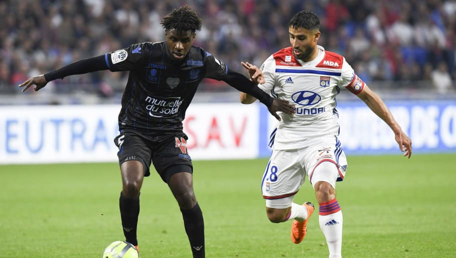 Lyon's French midfielder Nabil Fekir (R) vies with Nice's French midfielder Adrien Tameze (L) during the French L1 football match between Olympique Lyonnais and OGC Nice, on May 19, 2018, at the Groupama Stadium in Decines-Charpieu near Lyon, central-eastern France. (Photo by PHILIPPE DESMAZES / AFP)        (Photo credit should read PHILIPPE DESMAZES/AFP/Getty Images)