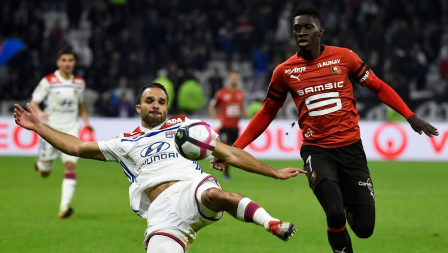 Lyon's French defender Jeremy Morel (L) vies with Rennes' Senegalese forward Ismaila Sarr during the French L1 football match between Olympique Lyonnais and Stade Rennais Football Club at the Groupama stadium in Lyon, central-eastern France on December 5, 2018. (Photo by JEAN-PHILIPPE KSIAZEK / AFP)        (Photo credit should read JEAN-PHILIPPE KSIAZEK/AFP/Getty Images)