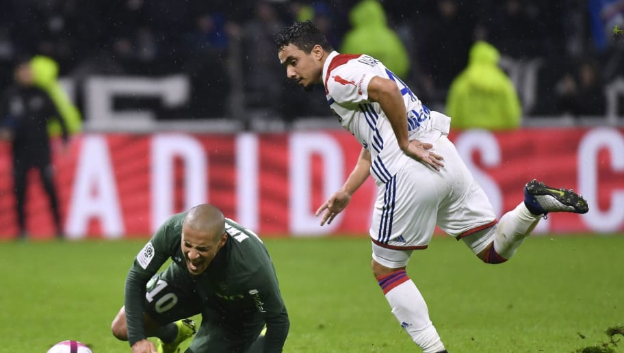 Lyon's Brazilian defender Rafael da Silva (R) vies with Saint-Etienne's  Tunisian midfielder Wahbi Khazri (L) during  the French L1 football match between Lyon (OL) and Saint-Etienne (ASSE) on November 23, 2018, at the Groupama Stadium in Decines-Charpieu, near Lyon, central-eastern France. (Photo by PHILIPPE DESMAZES / AFP)        (Photo credit should read PHILIPPE DESMAZES/AFP/Getty Images)