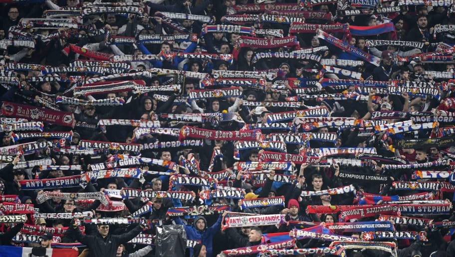 Lyon's supporters wave scarves during the French L1 football match between Olympique Lyonnais and AS Saint-Etienne at the Groupama Stadium in Decines-Charpieu, near Lyon, central-eastern France on November 23 , 2018. (Photo by PHILIPPE DESMAZES / AFP)        (Photo credit should read PHILIPPE DESMAZES/AFP/Getty Images)