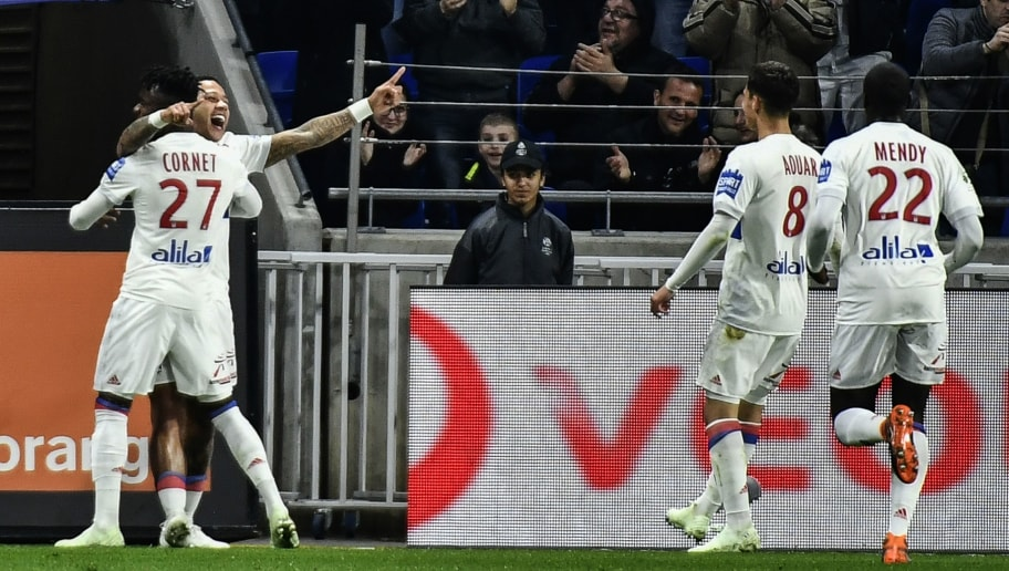 Lyon's Dutch forward Memphis Depay (2L) celebrates with teammates French forward Maxwel Cornet (L), forward Houssem Aouar (2R) and French defender Ferland Mendy (R) after scoring a goal during the French L1 football match Olympique Lyonnais (OL) vs Toulouse FC (TFC) at the Parc Olympique Lyonnais stadium in Decines-Charpieu, central-eastern France on April 1, 2018. / AFP PHOTO / JEFF PACHOUD        (Photo credit should read JEFF PACHOUD/AFP/Getty Images)