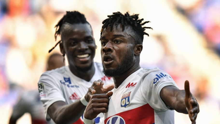 Lyon's French forward Maxwel Cornet (R) celebrates with Lyon's Burkinabe forward Bertrand Traore (L) after scoring a goal during the French L1 football match Olympique Lyonnais (OL) vs ESTAC Troyes on May 6, 2018, at the Parc Olympique Lyonnais stadium in Decines-Charpieu, central-eastern France. (Photo by JEFF PACHOUD / AFP)        (Photo credit should read JEFF PACHOUD/AFP/Getty Images)