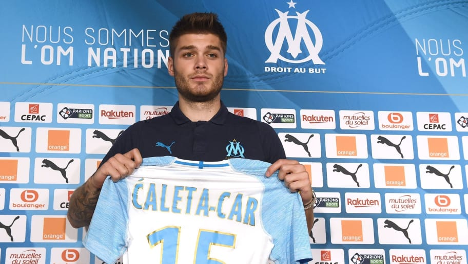 Marseille's newly recruited Croatian defender Duje Caleta-Car holds his new jersey during his official presentation at the Robert-Louis Dreyfus training centre in Marseille, southern France, on July 20, 2018. (Photo by Boris HORVAT / AFP)        (Photo credit should read BORIS HORVAT/AFP/Getty Images)
