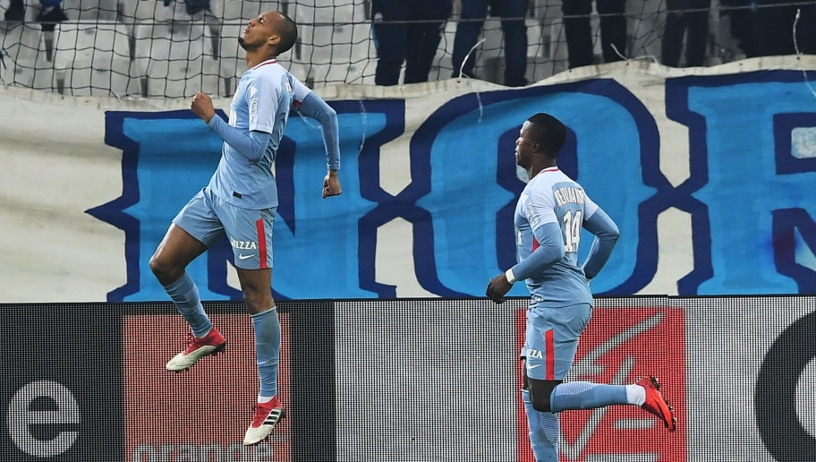 Monaco's Brazilian defender Fabinho (L) celebrates after scoring a goal during the French L1 football match Marseille vs Monaco, on January 28, 2018 at the Velodrome stadium in Marseille, southern France.  / AFP PHOTO / ANNE-CHRISTINE POUJOULAT        (Photo credit should read ANNE-CHRISTINE POUJOULAT/AFP/Getty Images)