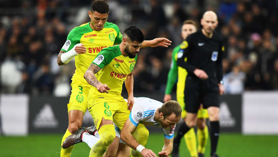 Nantes' Brazilian defender Lima (C) and Nantes' Brazilian defender Diego Carlos (L) vie with Olympique de Marseille's French forward Valere Germain (R) on March 04, 2018 at the Velodrome stadium in Marseille, southern France, during the French L1 football match Marseille vs Nantes. / AFP PHOTO / ANNE-CHRISTINE POUJOULAT        (Photo credit should read ANNE-CHRISTINE POUJOULAT/AFP/Getty Images)