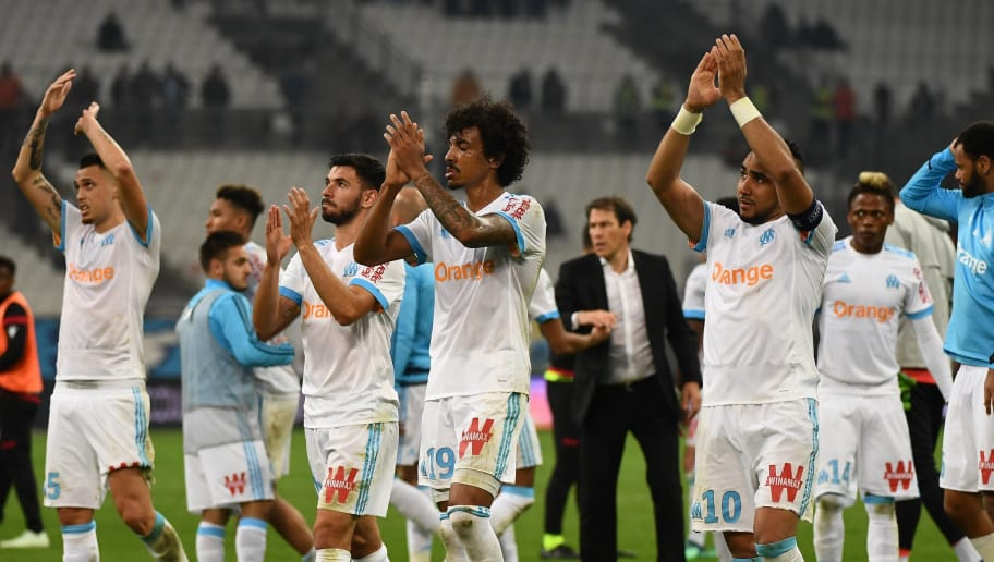 Olympique de Marseille's players celebrate their victory at the end of the French L1 football match Olympique of Marseille (OM) versus Nice at the Velodrome stadium in Marseille on May 6, 2018. (Photo by Boris HORVAT / AFP)        (Photo credit should read BORIS HORVAT/AFP/Getty Images)