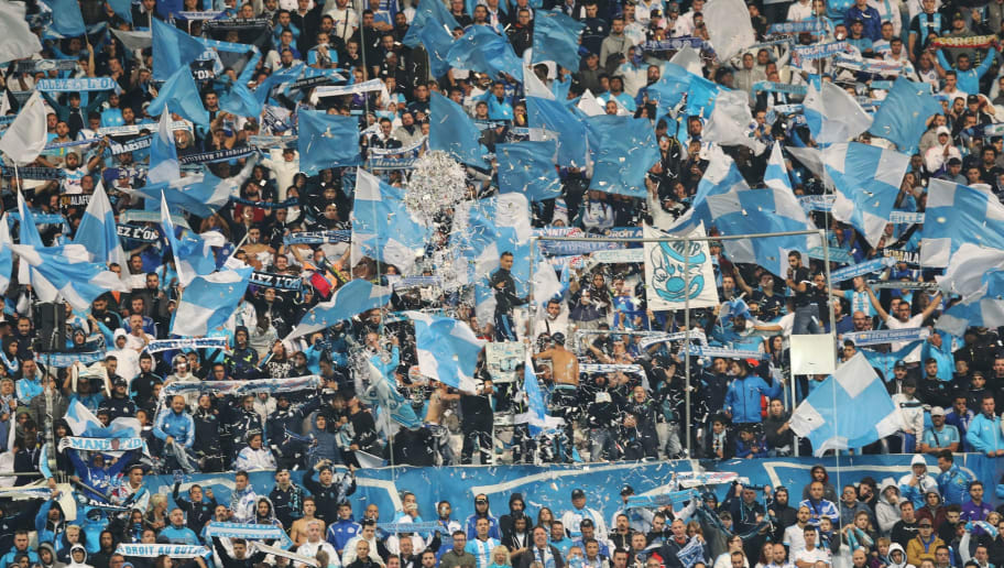 Marseille's supporters wave flags  during the French L1 football match between Marseille (OM) and Paris Saint-Germain (PSG) on October 22, 2017, at the Velodrome Stadium in Marseille, southeastern France. / AFP PHOTO / Valery HACHE        (Photo credit should read VALERY HACHE/AFP/Getty Images)