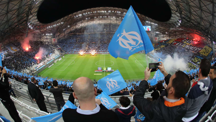 Marseille's supporters wave flags before the  French L1 football match between Marseille (OM) and Paris Saint-Germain (PSG) on October 22, 2017, at the Velodrome Stadium in Marseille, southeastern France. / AFP PHOTO / Valery HACHE        (Photo credit should read VALERY HACHE/AFP/Getty Images)