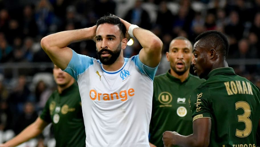 Marseille's French defender Adil Rami reacts after failing to score during the French L1 football match between Olympique de Marseille (OM) and Reims at the Velodrome stadium in Marseille on December 2, 2018 southern France. (Photo by GERARD JULIEN / AFP)        (Photo credit should read GERARD JULIEN/AFP/Getty Images)