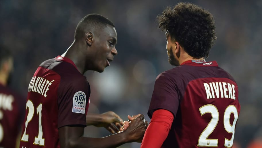 Metz' French forward Emmanuel Riviere (R) celebrates with Metz' French defender Moussa Niakhate   after scoring a goal  during the French L1 football match between Metz (FCM) and Strasbourg (RCS) on December 20, 2017, at the Saint Symphorien Stadium in Longeville-Les-Metz, eastern France. / AFP PHOTO / JEAN-CHRISTOPHE VERHAEGEN        (Photo credit should read JEAN-CHRISTOPHE VERHAEGEN/AFP/Getty Images)