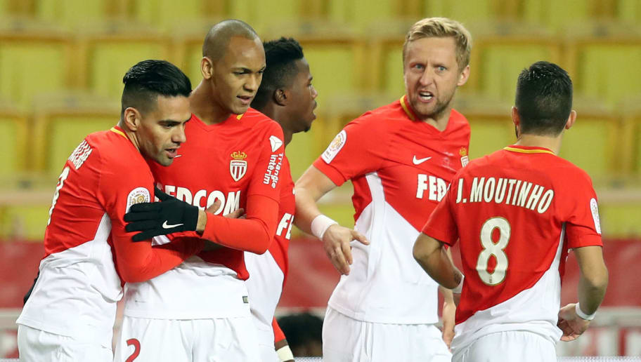 Monaco's Colombian forward Radamel Falcao (L) celebrates with Monaco's Brazilian defender Fabinho (2ndL) and Monaco's Polish defender Kamil Glik (2ndR) after scoring a goal during the French L1 football match Monaco vs Angers on December 2, 2017 at the Louis II stadium in Monaco.   / AFP PHOTO / VALERY HACHE        (Photo credit should read VALERY HACHE/AFP/Getty Images)