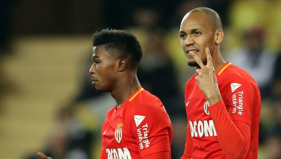 Monaco's Brazilian defender Fabinho (R) celebrates after scoring a penalty during the French L1 football match Monaco vs Dijon on February 16, 2018 at the 'Louis II Stadium' in Monaco.   / AFP PHOTO / VALERY HACHE        (Photo credit should read VALERY HACHE/AFP/Getty Images)