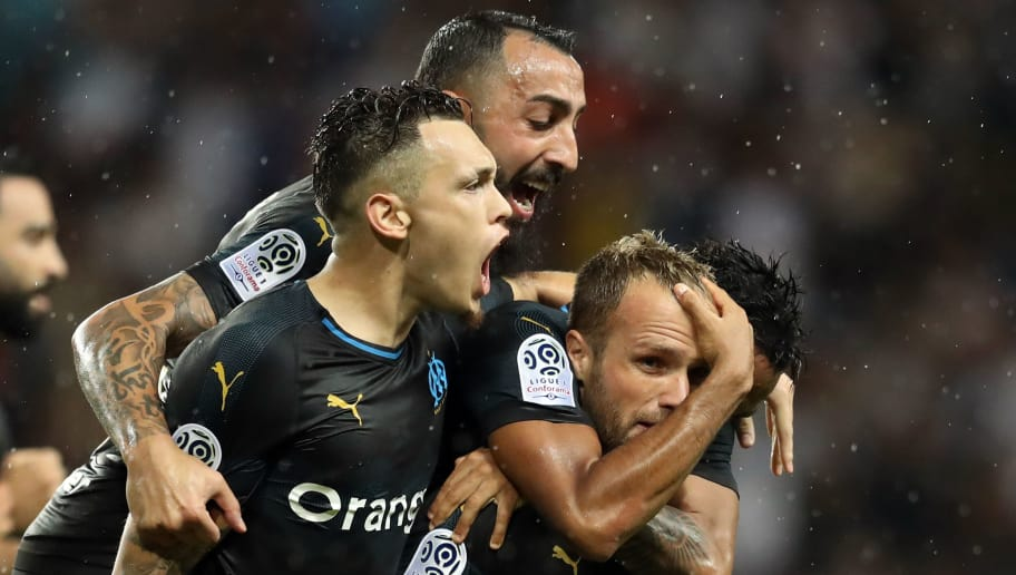 Marseille's French forward Valere Germain (2ndR) is congratulated by teammates after scoring a goal during the French L1 football match between AS Monaco (ASM) and Olympique de Marseille (OM), on September 2, 2018 at the Louis II stadium in Monaco. (Photo by Valery HACHE / AFP)        (Photo credit should read VALERY HACHE/AFP/Getty Images)
