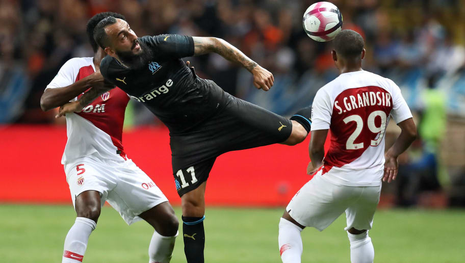Marseille's Greek forward Konstantinos Mitroglou (C) vies with Marseille's Argentine midfielder Lucas Ocampos (L) and Monaco's French midfielder Samuel Grandsir (R) during the French L1 football match between AS Monaco (ASM) and Olympique de Marseille (OM), on September 2, 2018 at the Louis II stadium in Monaco. (Photo by Valery HACHE / AFP)        (Photo credit should read VALERY HACHE/AFP/Getty Images)