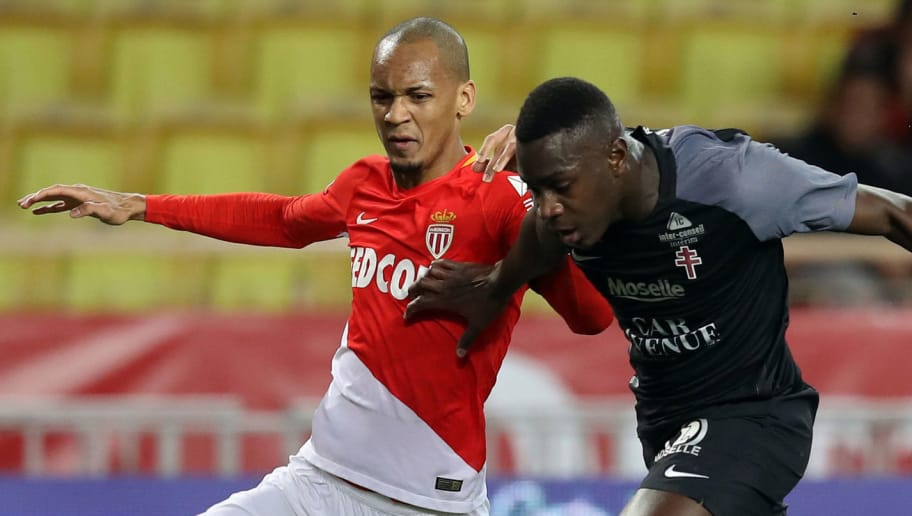 Monaco's Brazilian defender Fabinho (L) vies with Metz' French defender Moussa Niakhate during the French L1 football match Monaco versus Metz on January 21, 2018 at the Louis II Stadium in Monaco.   / AFP PHOTO / VALERY HACHE        (Photo credit should read VALERY HACHE/AFP/Getty Images)