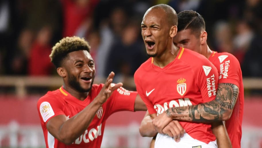 Monaco's Brazilian defender Fabinho (2R) jubilates after scoring, during the French L1 football match Monaco (ASM) vs St Etienne (ASSE)  on May 12, 2018 at the Louis II Stadium in Monaco. (Photo by Boris HORVAT / AFP)        (Photo credit should read BORIS HORVAT/AFP/Getty Images)
