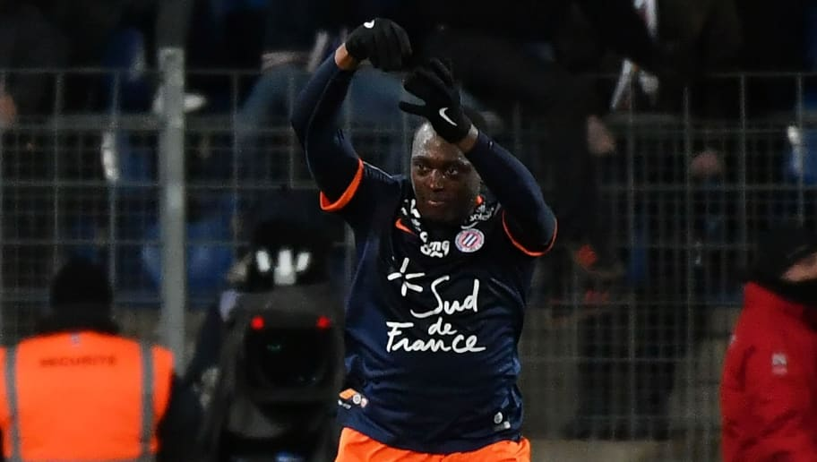 Montpellier's French defender Jerome Roussillon celebrates after scoring a goal during the French L1 football match between MHSC Montpellier and Dijon, on January 14, 2017 at the La Mosson Stadium in Montpellier, southern France. / AFP / PASCAL GUYOT        (Photo credit should read PASCAL GUYOT/AFP/Getty Images)