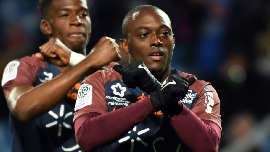 Montpellier's French defender Jerome Roussillon (C) celebrates with teammates after scoring a goal during the French L1 football match between MHSC Montpellier and Lille, on November 25, 2017 at the La Mosson Stadium in Montpellier, southern France. / AFP PHOTO / PASCAL GUYOT        (Photo credit should read PASCAL GUYOT/AFP/Getty Images)