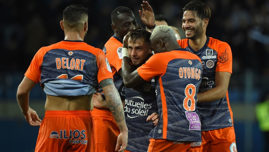 Montpellier's French defender Ruben Aguilar (C) celebrates with his teammates after scoring a goal during the French L1 football match between Montpellier and Lyon, on December 22, 2018 at the Mosson Stadium in Montpellier, southern France. (Photo by SYLVAIN THOMAS / AFP)        (Photo credit should read SYLVAIN THOMAS/AFP/Getty Images)