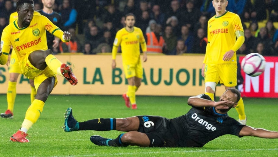 Nantes' French midfielder Abdoulaye Toure (L) shoots to score during the French L1 football match between FC Nantes and Olympique de Marseille at the La Beaujoire stadium in Nantes, western France on December 5, 2018. (Photo by SEBASTIEN SALOM GOMIS / AFP)        (Photo credit should read SEBASTIEN SALOM GOMIS/AFP/Getty Images)