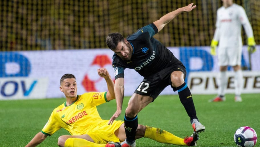Nantes' Brazilian midfielder Andrei Girotto (L) vies for the ball with Marseille's Dutch midfielder Kevin Strootman (R) during the French L1 football match between FC Nantes and Olympique de Marseille at the La Beaujoire stadium in Nantes, western France on December 5, 2018. (Photo by SEBASTIEN SALOM GOMIS / AFP)        (Photo credit should read SEBASTIEN SALOM GOMIS/AFP/Getty Images)